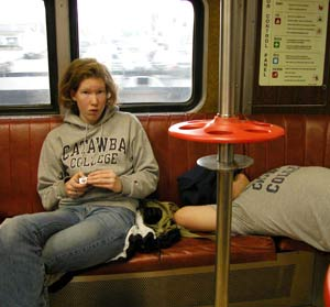Freshman Megan Fulsom of Mt. Pleasant, S.C. and fellow student ride NYC subway wearing Catawba clothing